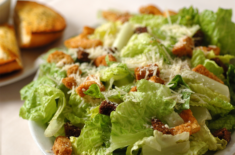 caesar salad with croutons and shaved parmesan