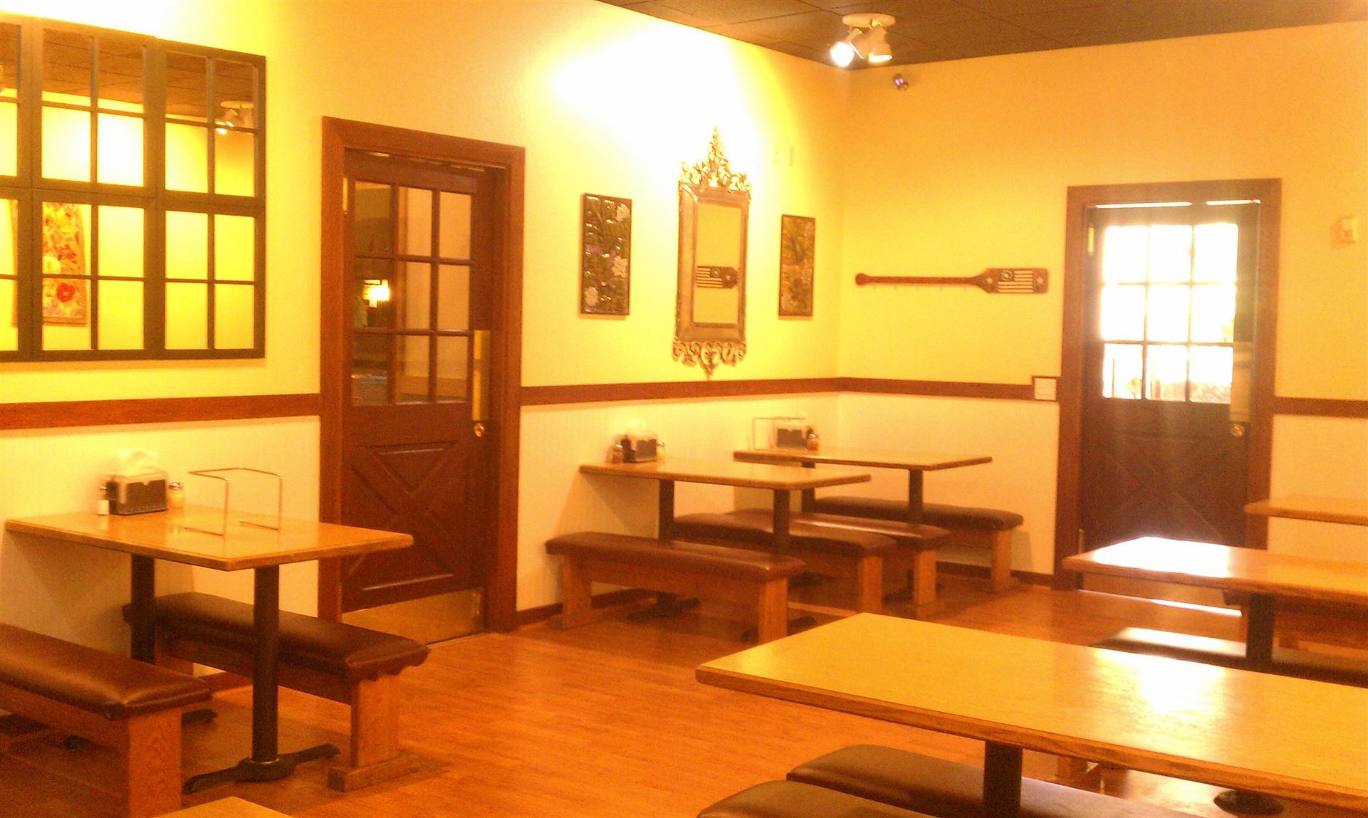 interior view of pavlo's pizza dining room with warm lighting and rustic style booths