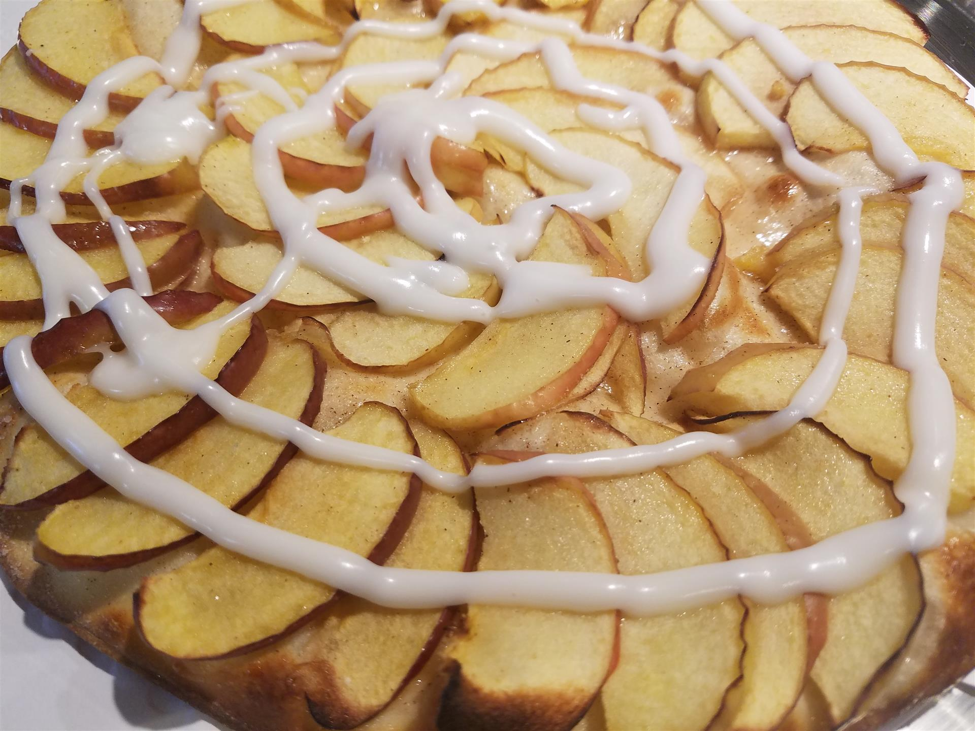 sliced apple pie drizzled with icing