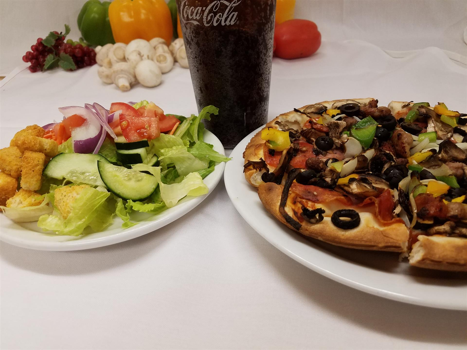 personal lunch special pizza with veggies served with a house salad and a soda