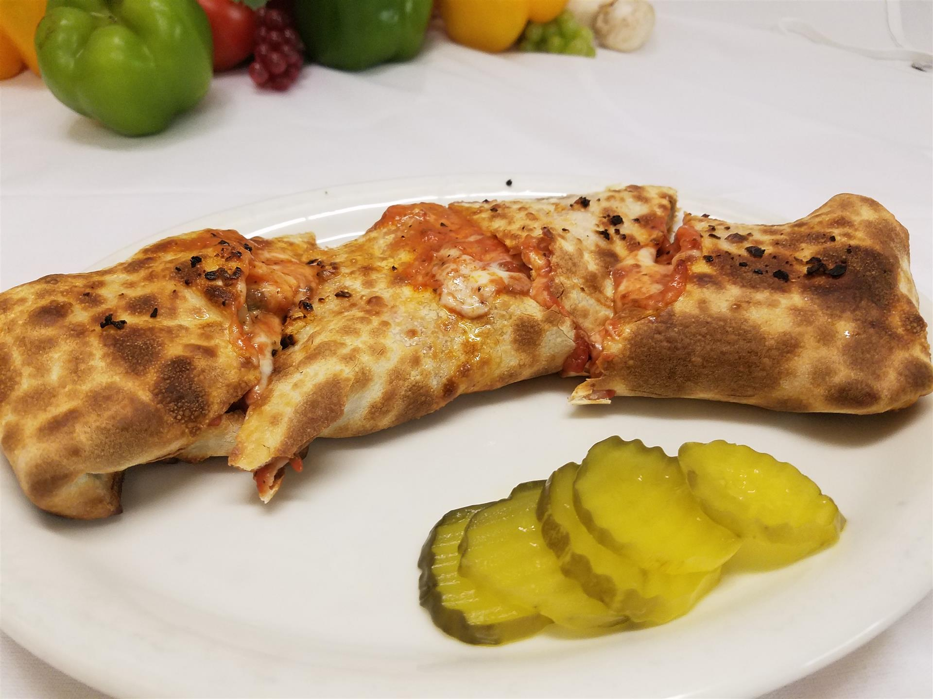 calzone with pickles on the side