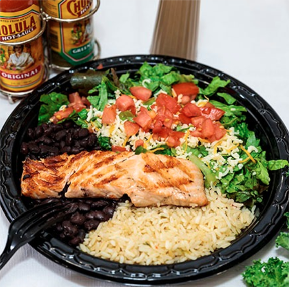 Salmon platter with black beans, rice, diced tomatoes and lettuce