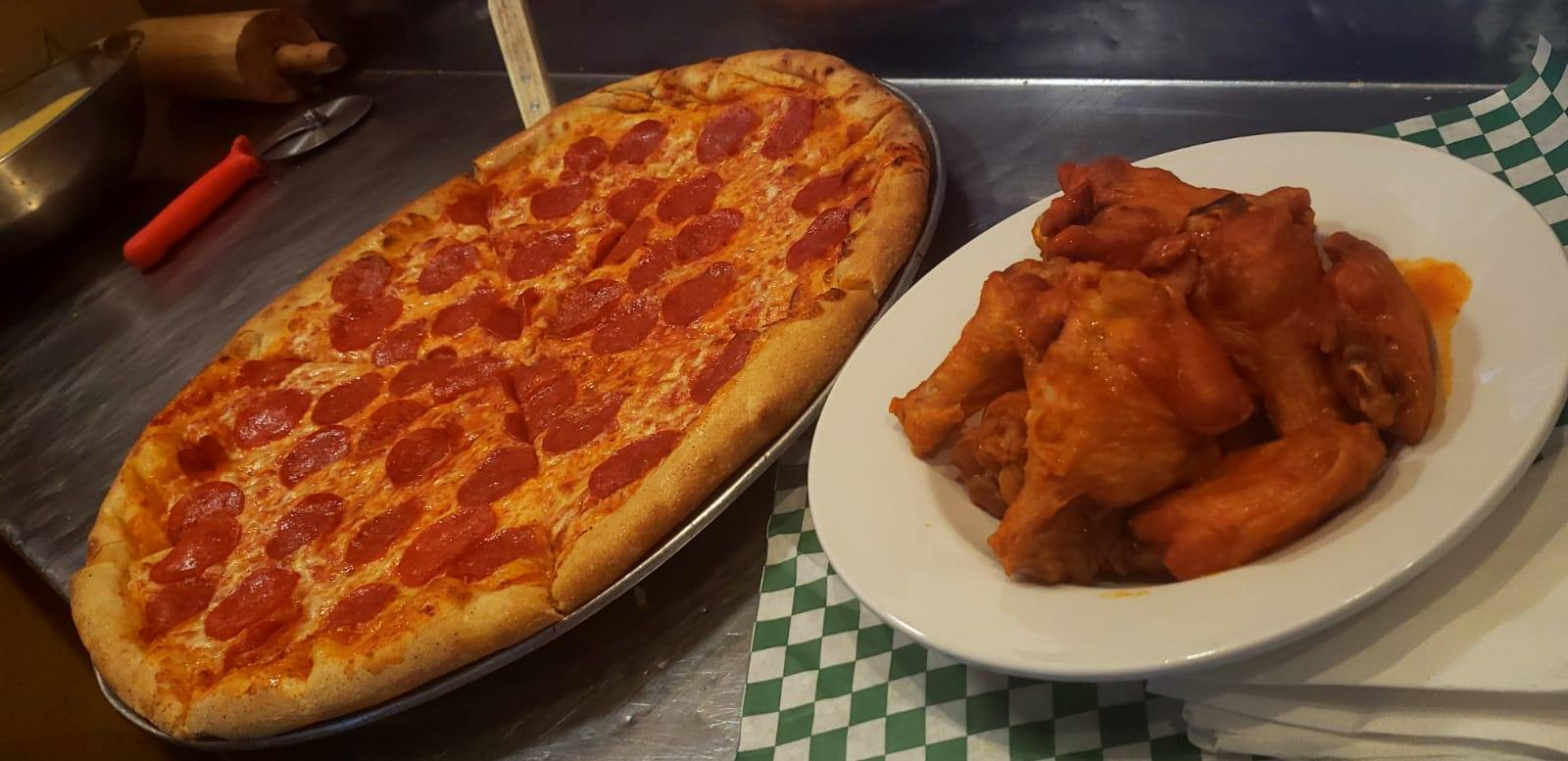 Pepperoni pizza and a bowl of buffalo chicken wings