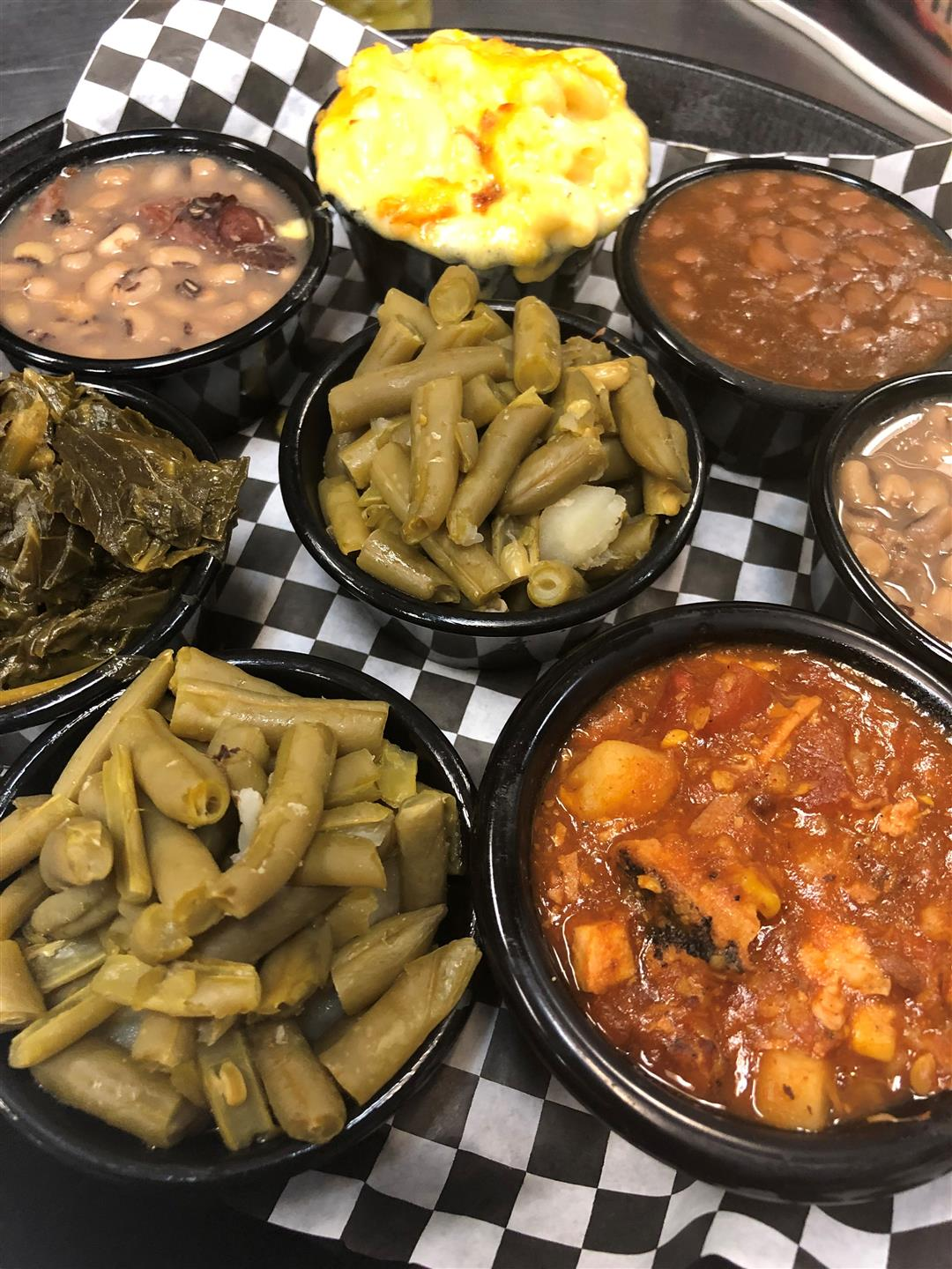 gren beans, collard greens, baked beans, black ayed peas, mac and cheese and other various sides all in little dishes
