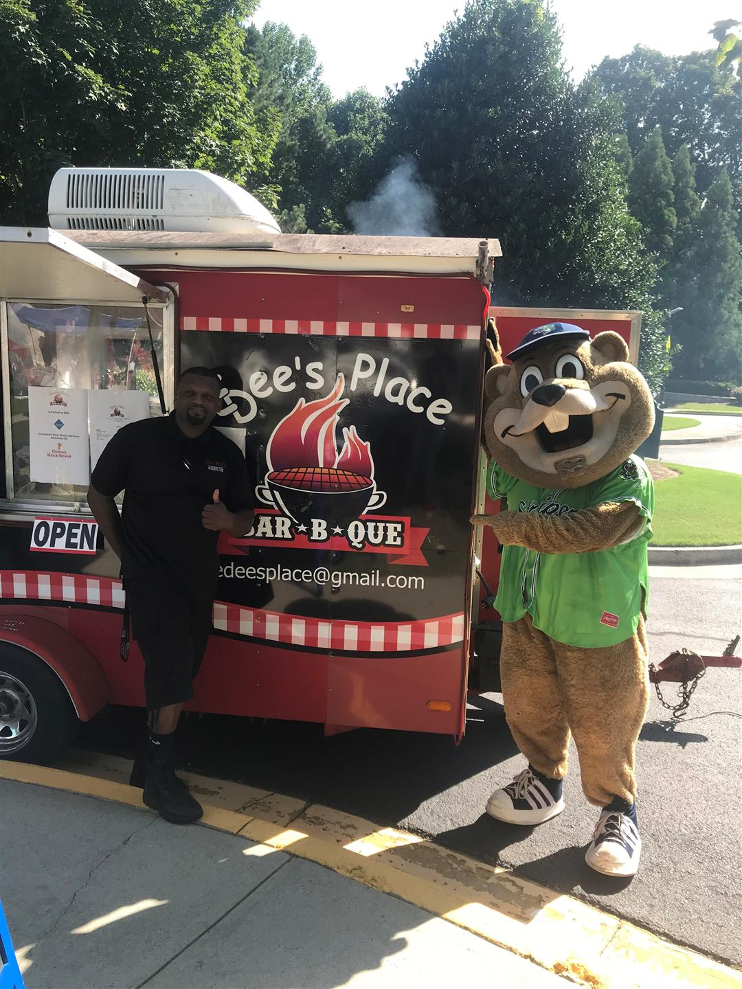 edmund and a mascot standing next to the Edee's Place food truck