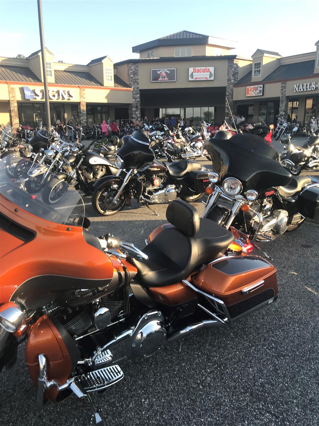motorcycles parked in a parking lot