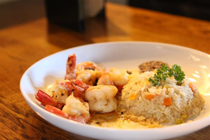 Grilled shrimp on a plate with vegetable rice