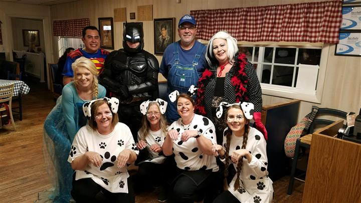 Group of adults dressed in costumes