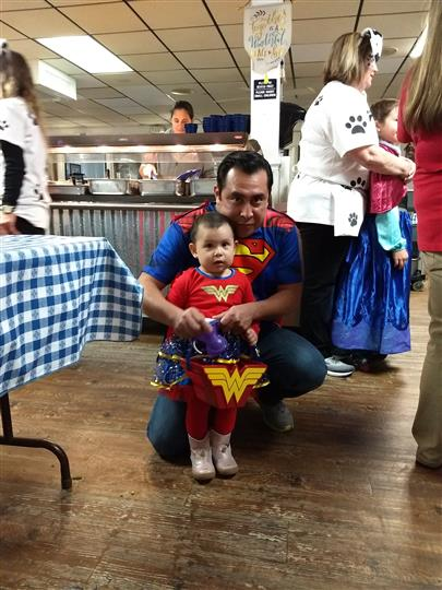 Father and daugter dressed in Halloween costumes at an event