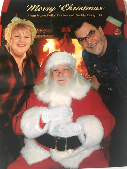 Rick and Tami Hall posing with Santa