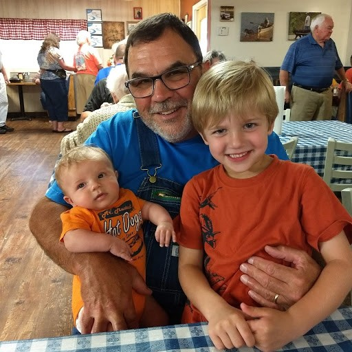 rick with 2 kids smiling in the restaurant