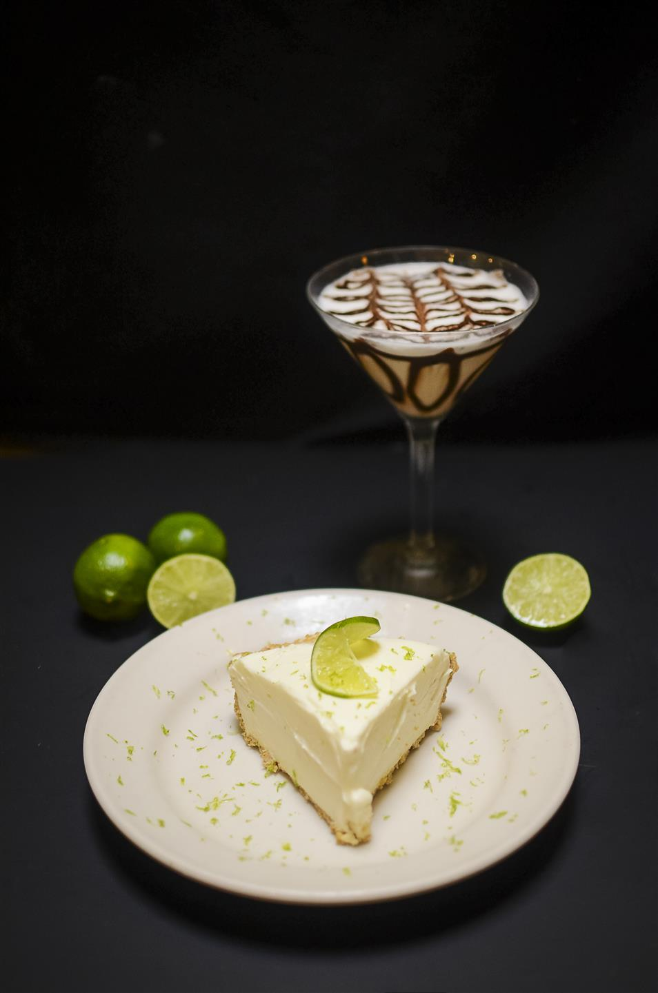 key lime cheesecake with fresh limes and a chocolate martini