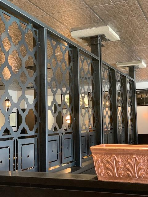interior shot of dining room booth dividers with a wine barrel design