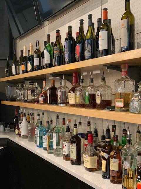 full bar shelves with various different types of liquor