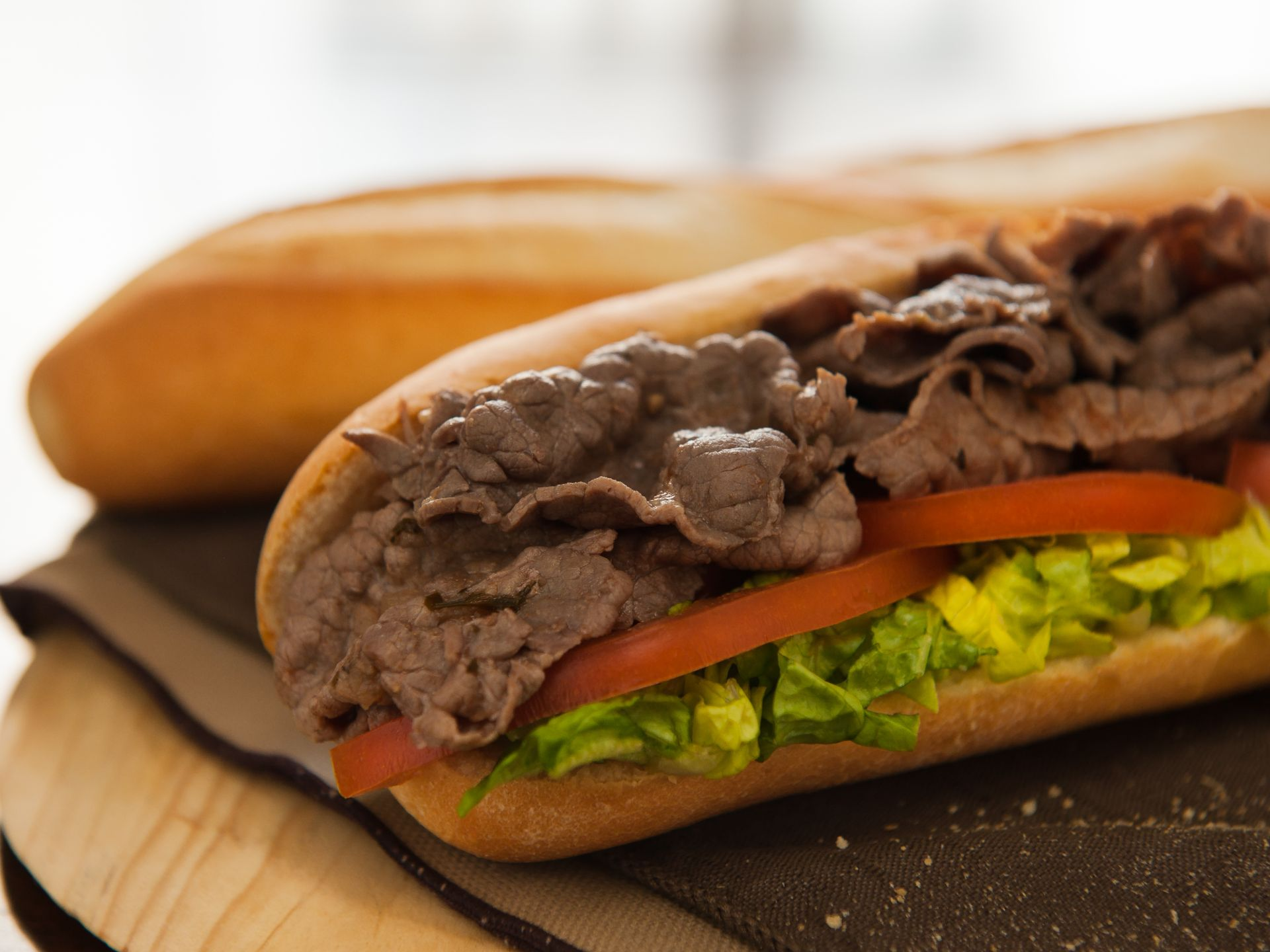 roast beef hero with lettuce and tomato