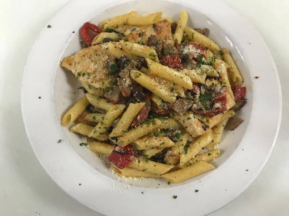 Penne pasta with grated cheese, cherry tomatoes and grilled chicken
