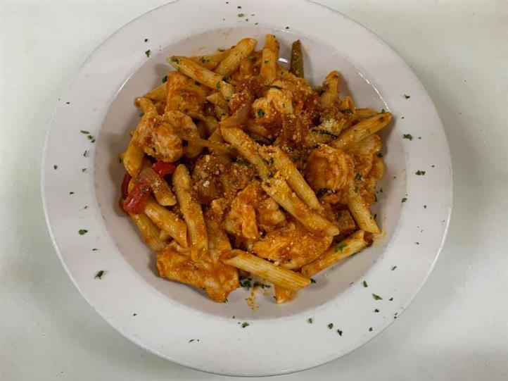 Penne pasta with tomato sauce and shrimp