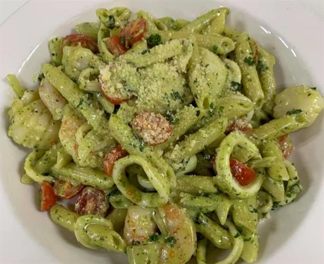 Pesto pasta with cherry tomatoes and shrimp