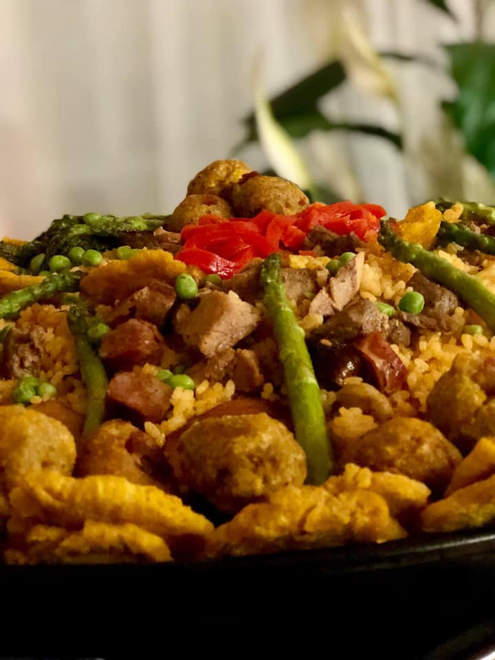 menu item with asparagus, meat and peppers piled up in a bowl