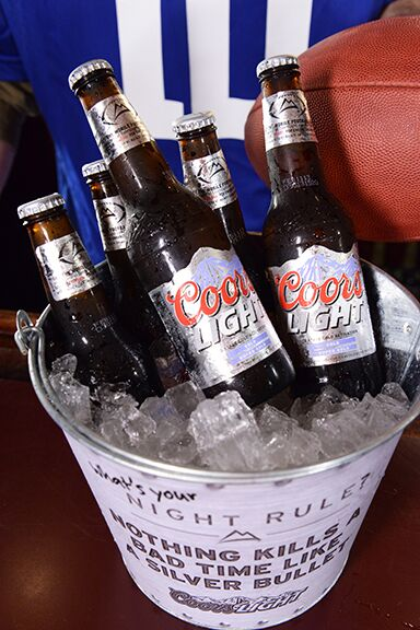 5 coors light in a bucket of ice