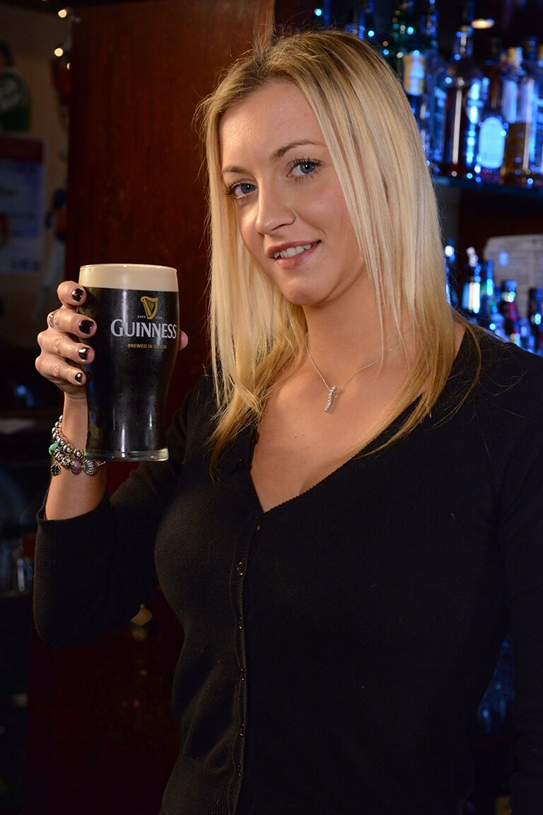 girl holding a glass of guinness