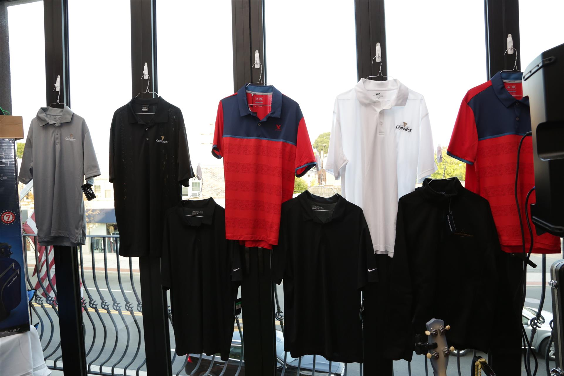 a variety of t shirts hanging up