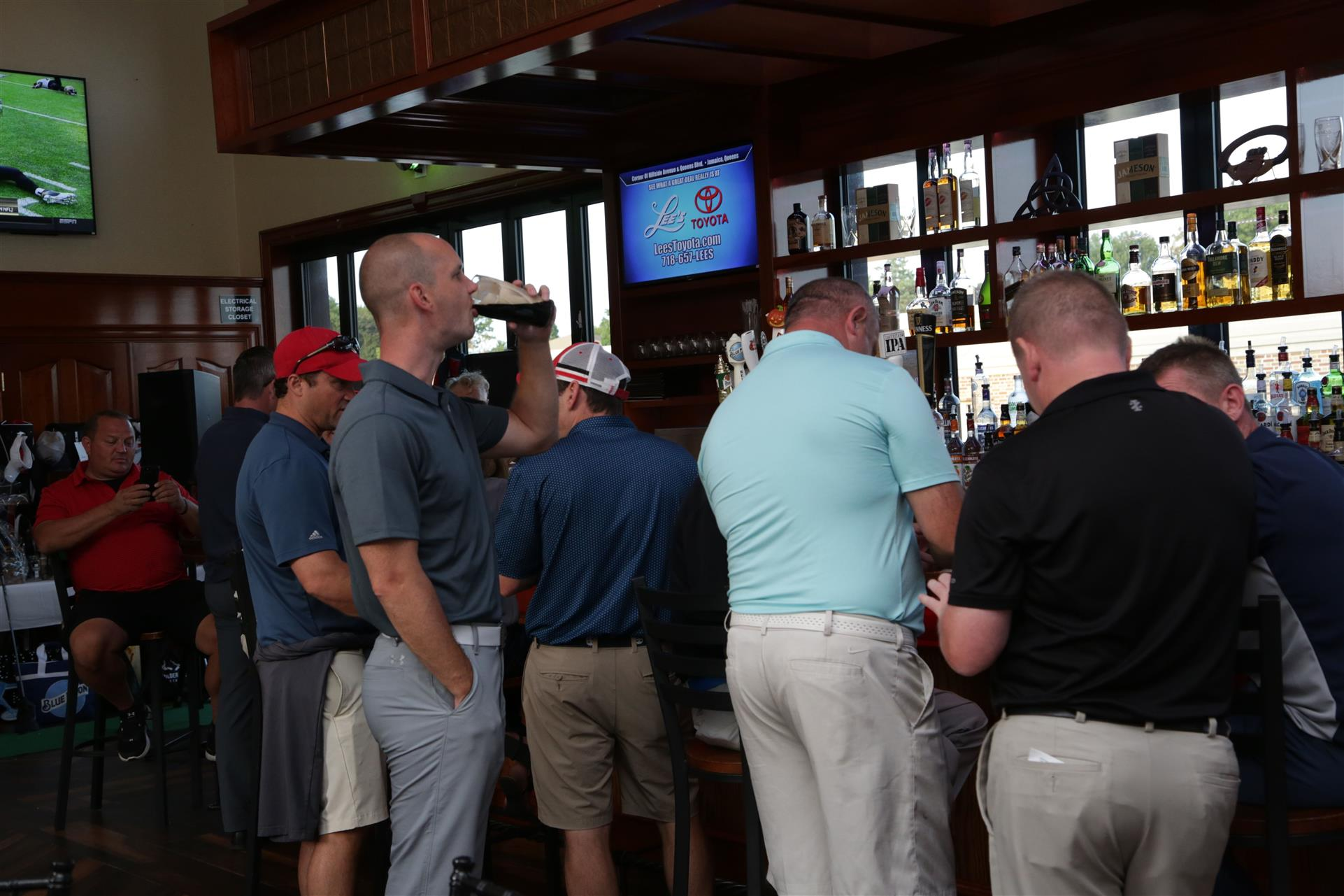 men standing at the bar