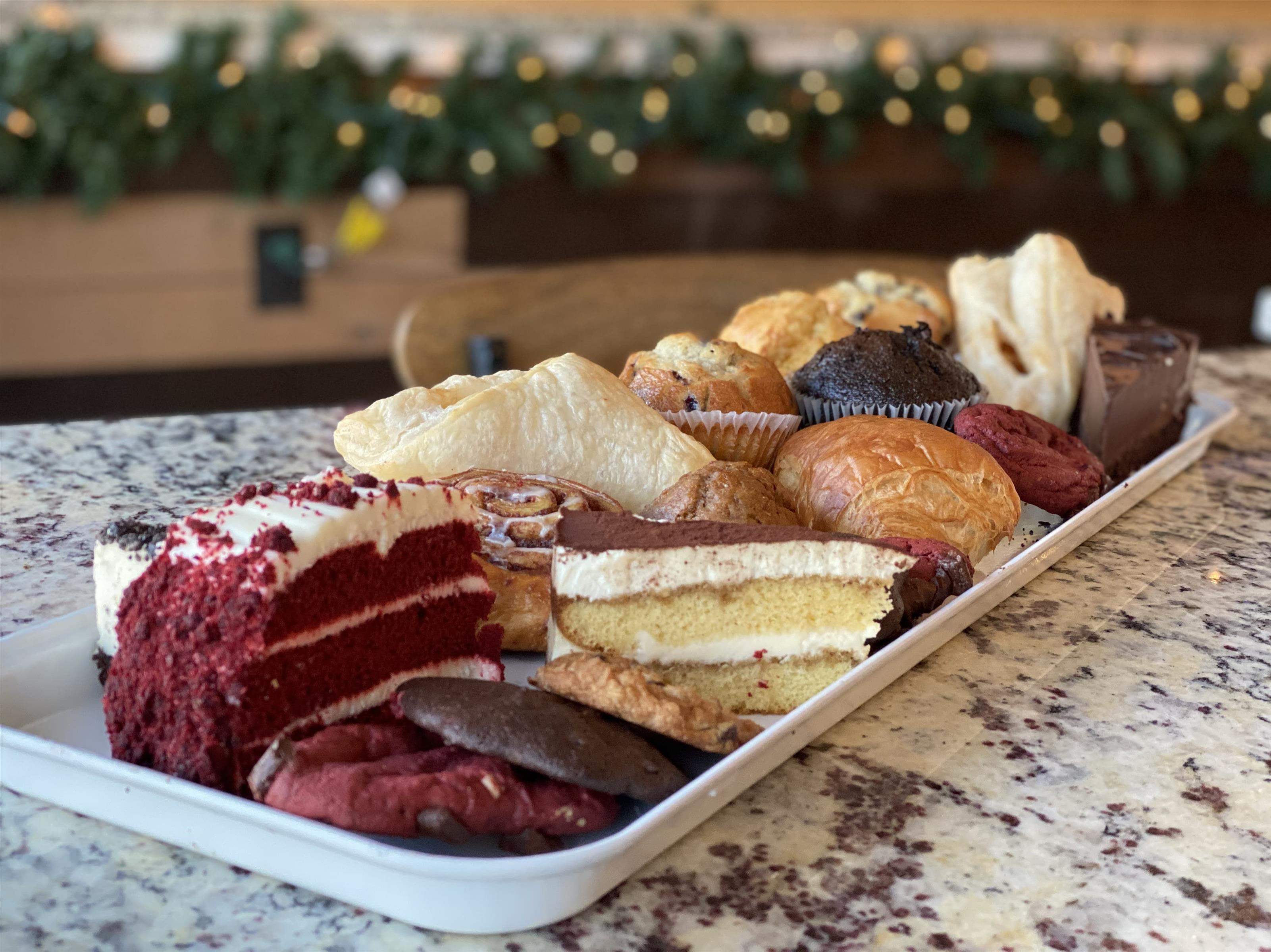 tray of a variety of cakes and pastries