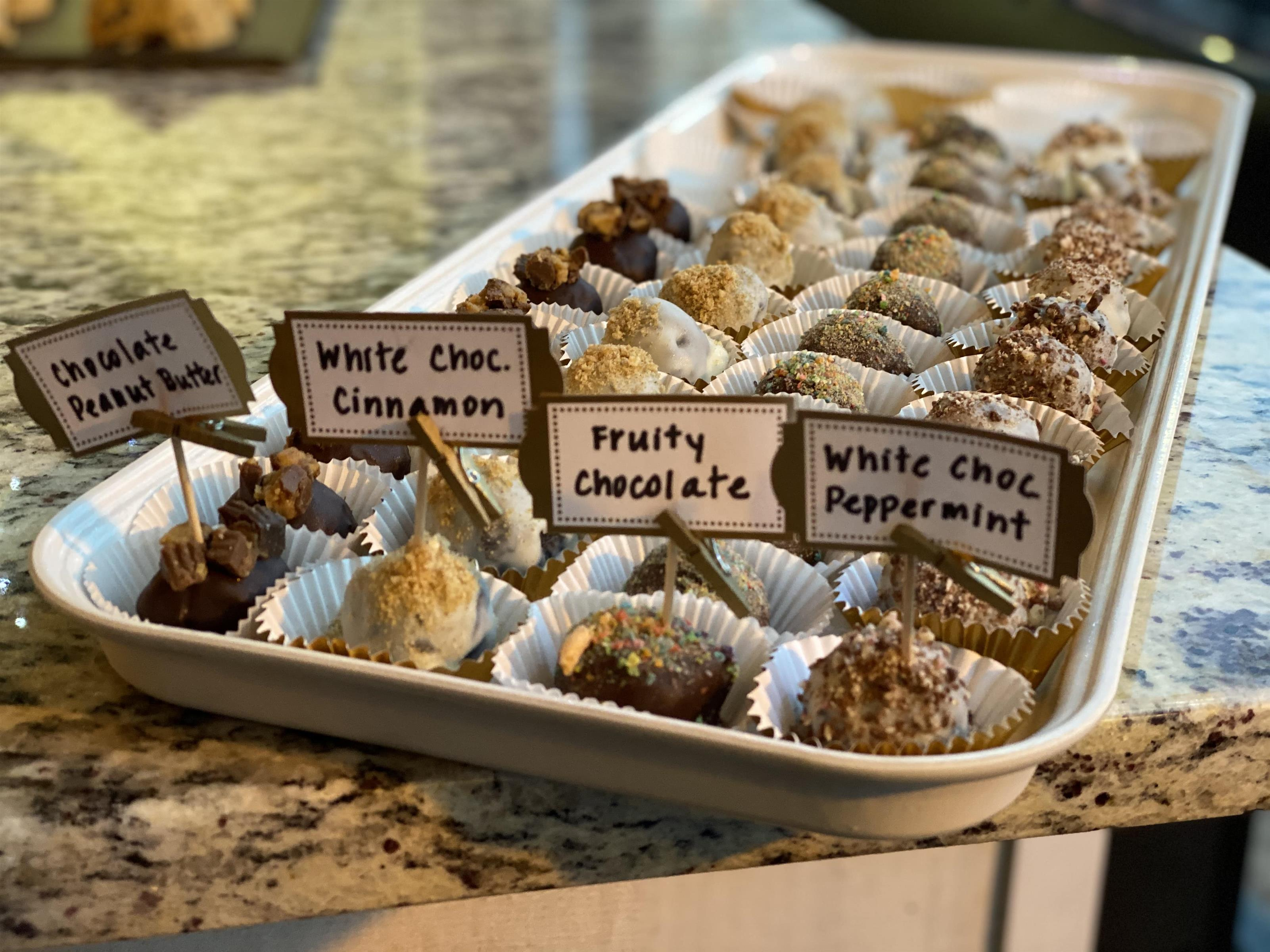 tray of oreo truffles with a variety of toppings