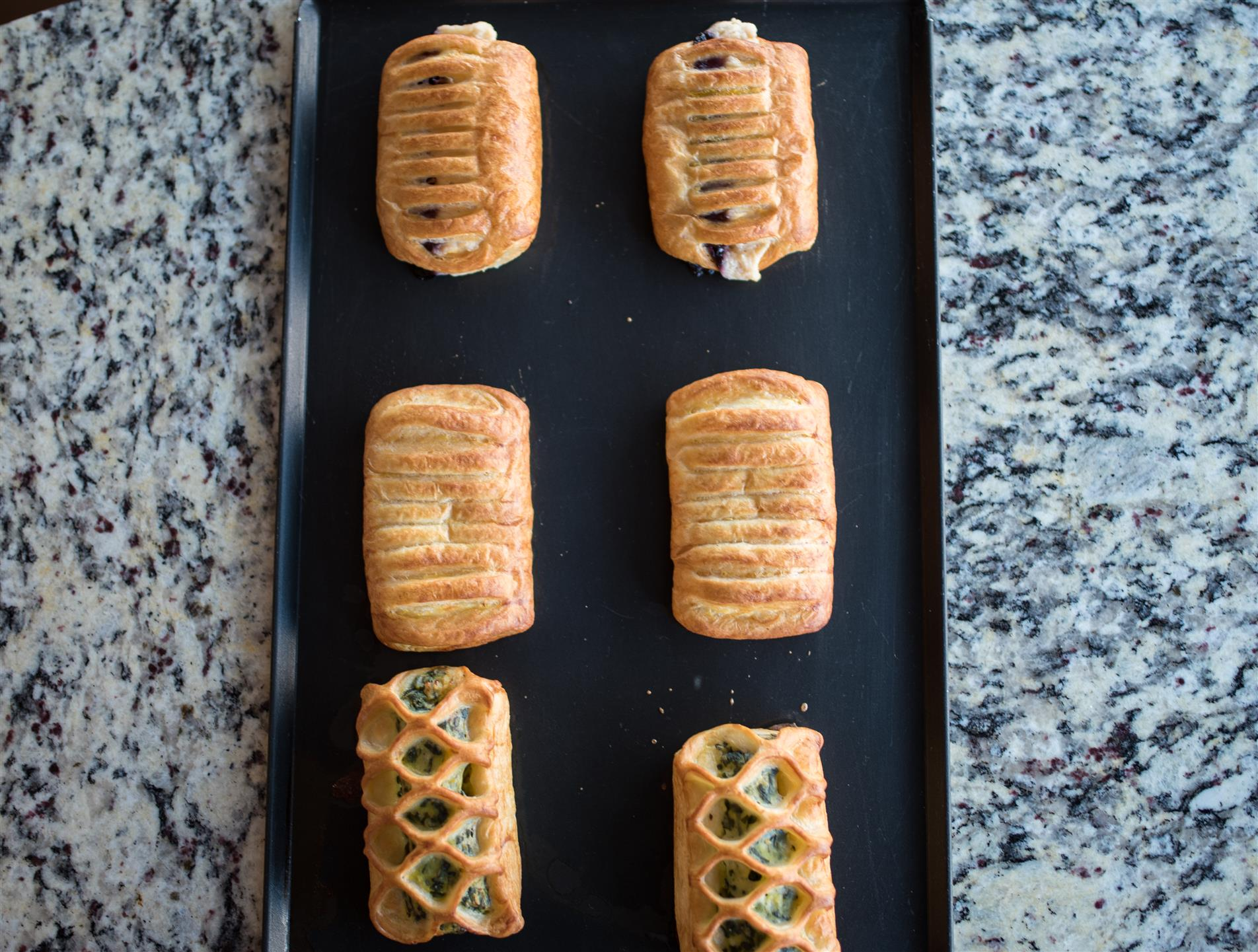 tray of two blueberry croissants, two sweet cheese croissants, two spinach feta bistros