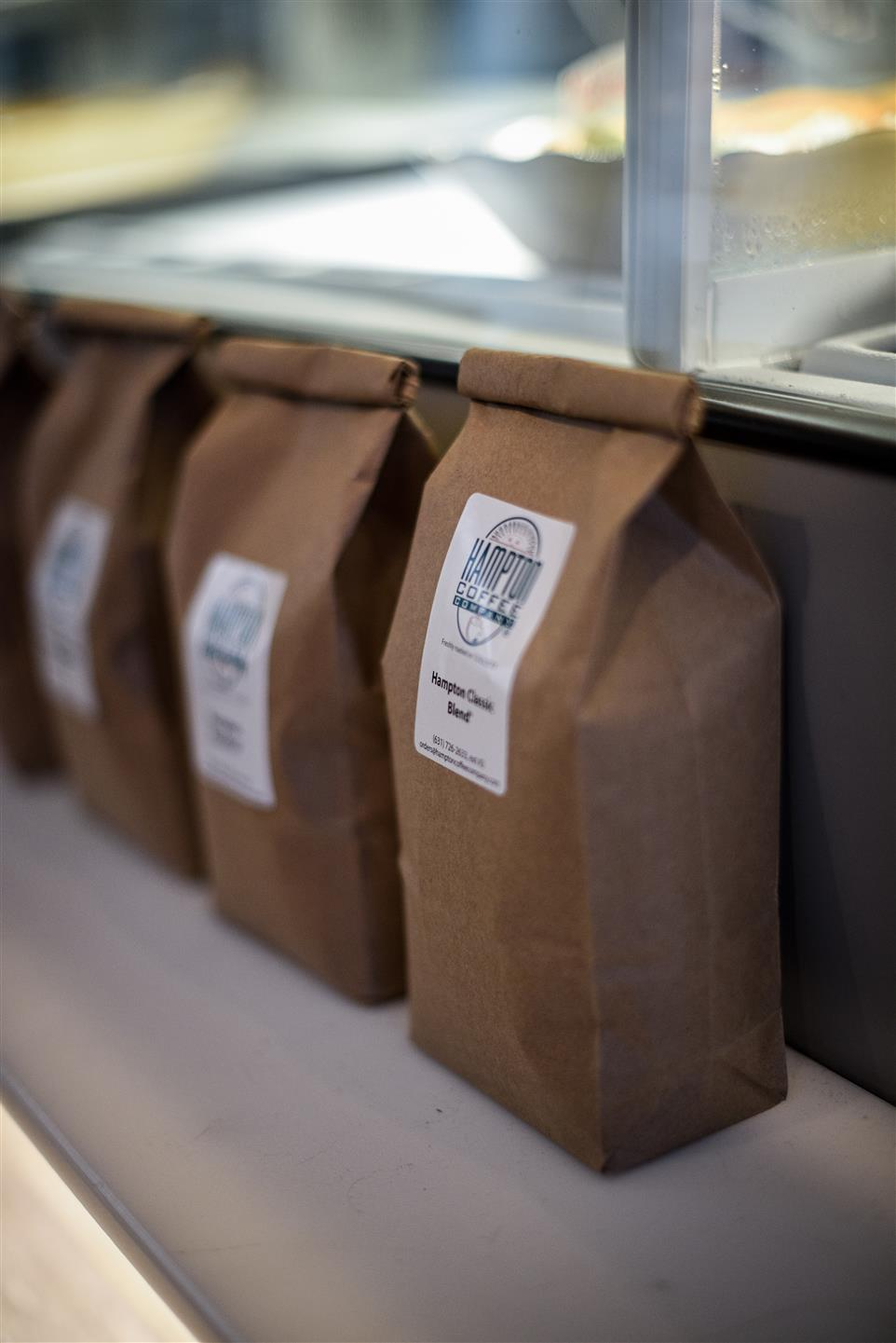 Bags of coffee lined up on display