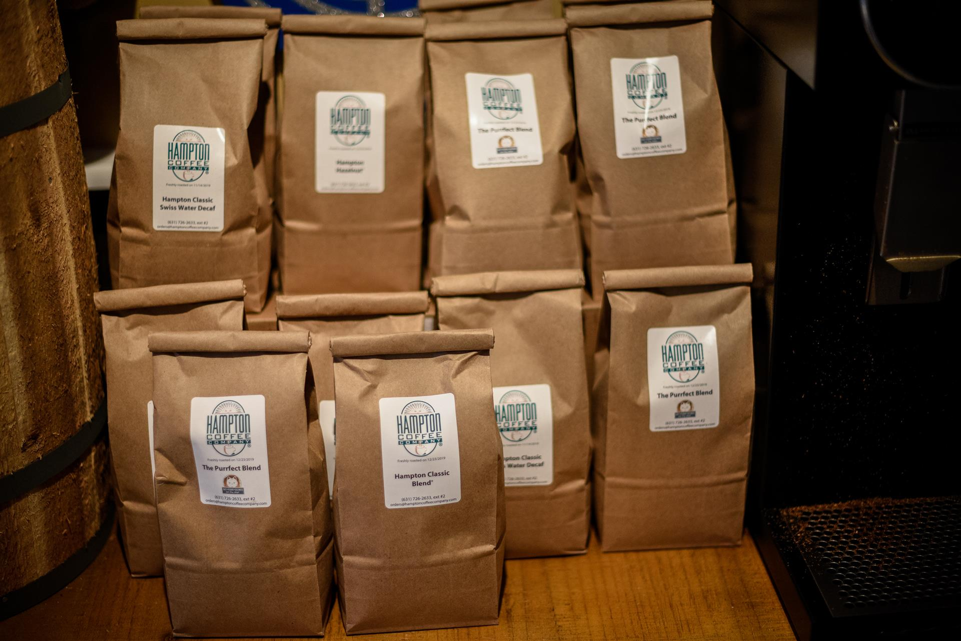 Many bags of coffee on table.