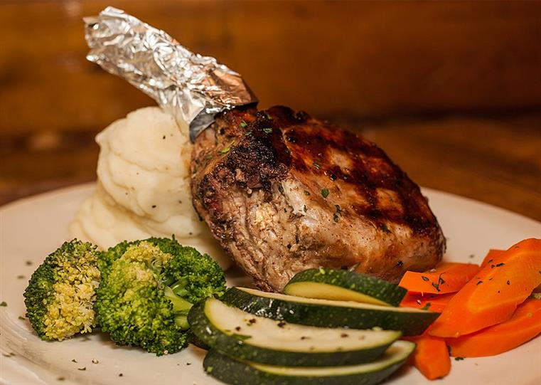lamb chop with broccoli and zucchini and carrots and mashed potatoes
