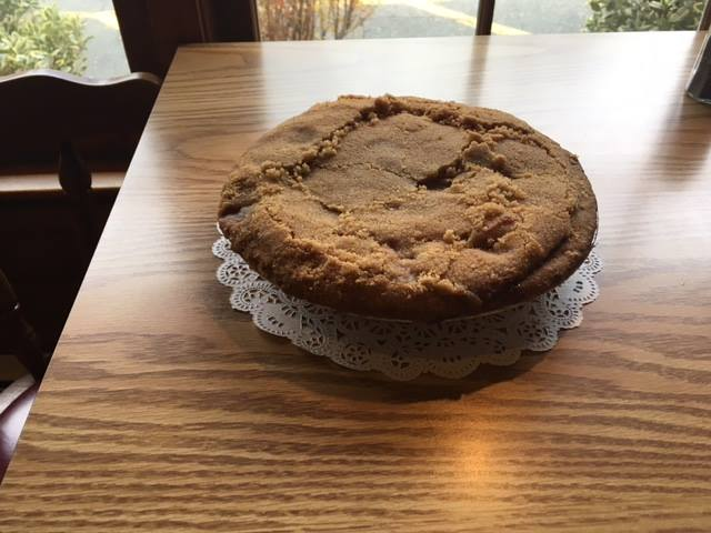 Fresh apple crumb pie on table