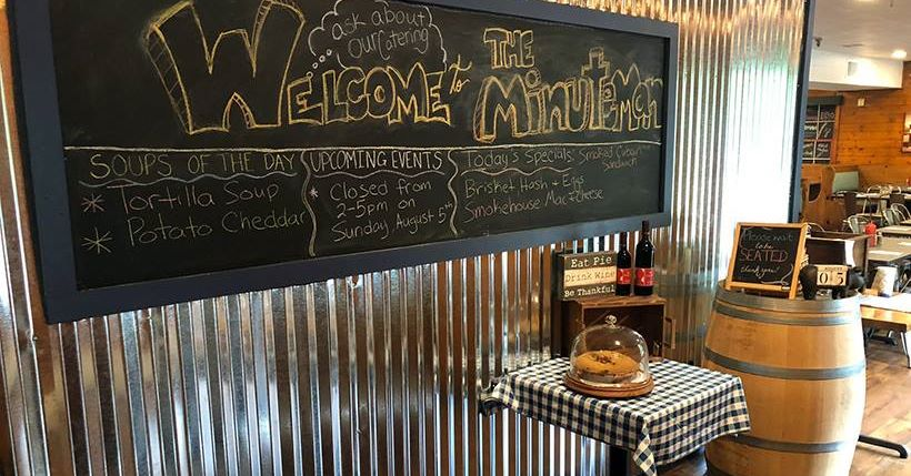 Welcome to the MInuteman. chalkboard menu with specials and events