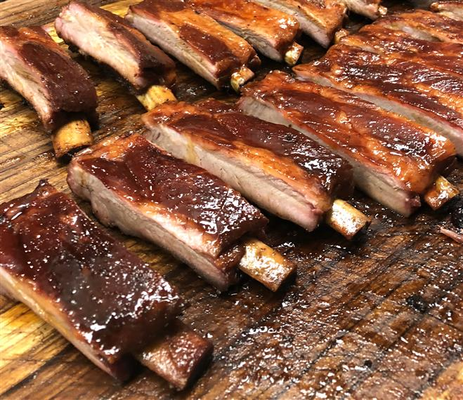 barbecue ribs on wood carving board