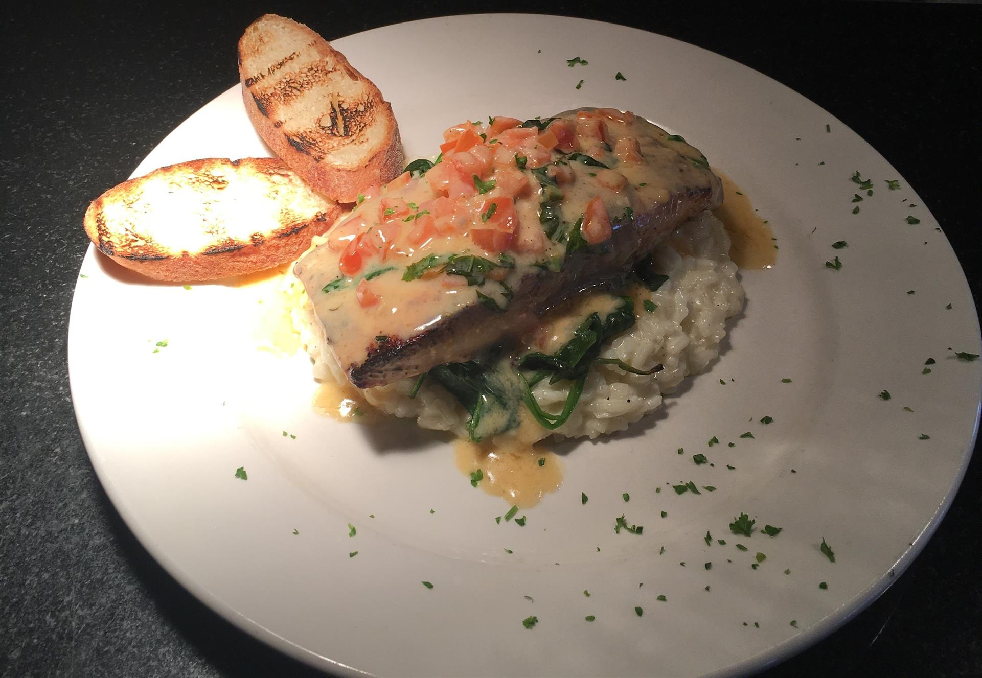 Oven Roasted Salmon over Garlic Mashed Potatoes and Brussel Sprouts. topped Orange Dijon Glaze