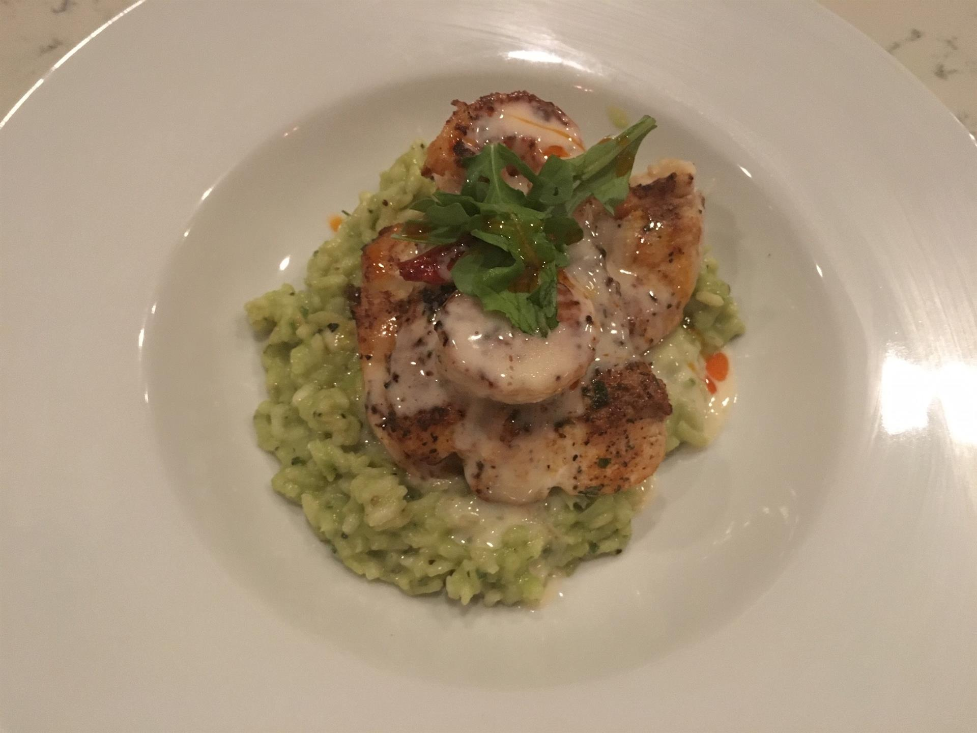 Sauteed scallops over risotto with basil