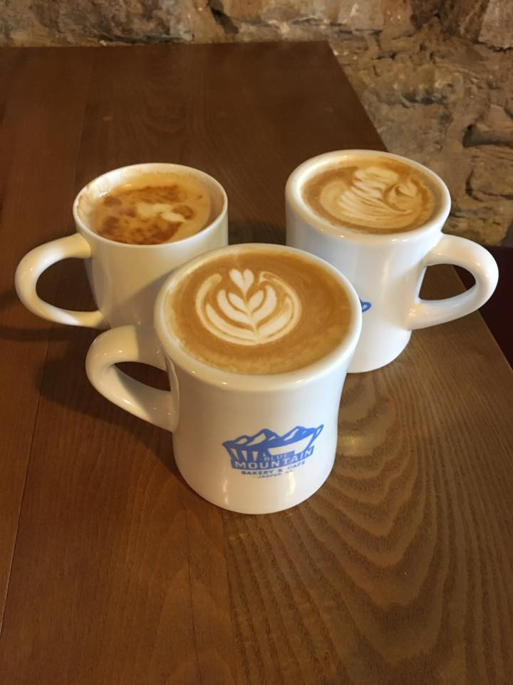 3 cups of coffee in blue mountain bakery and cafe cups