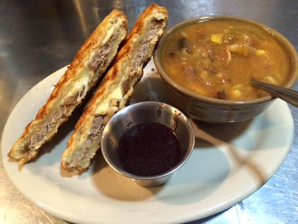 pressed cuban sandwich panini served with soup and an au jus