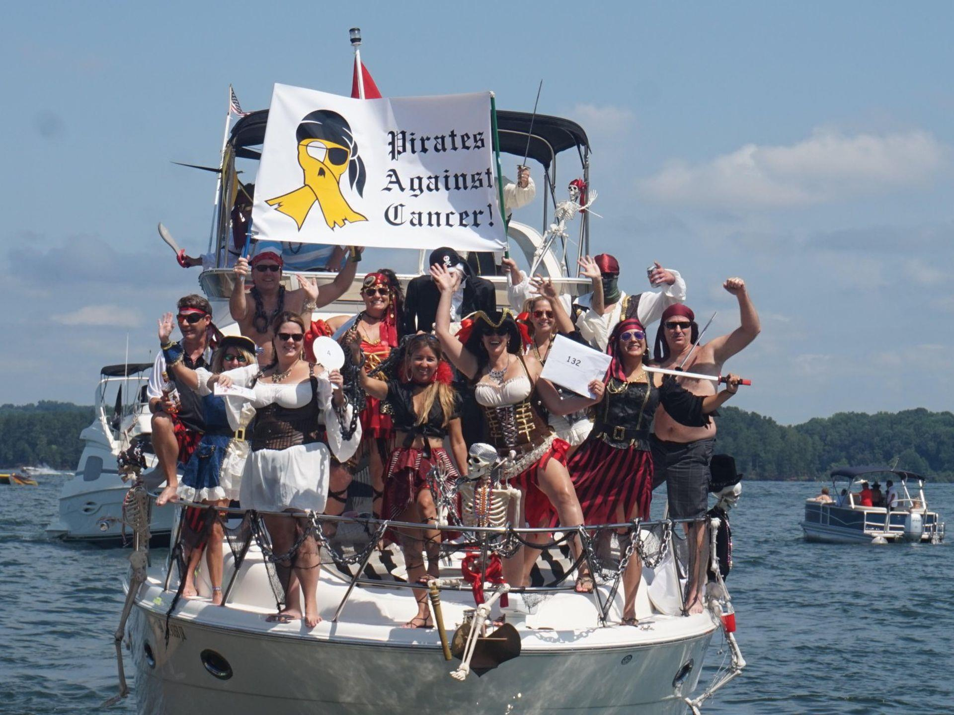 People dressed in Pirate attire standing on a boat