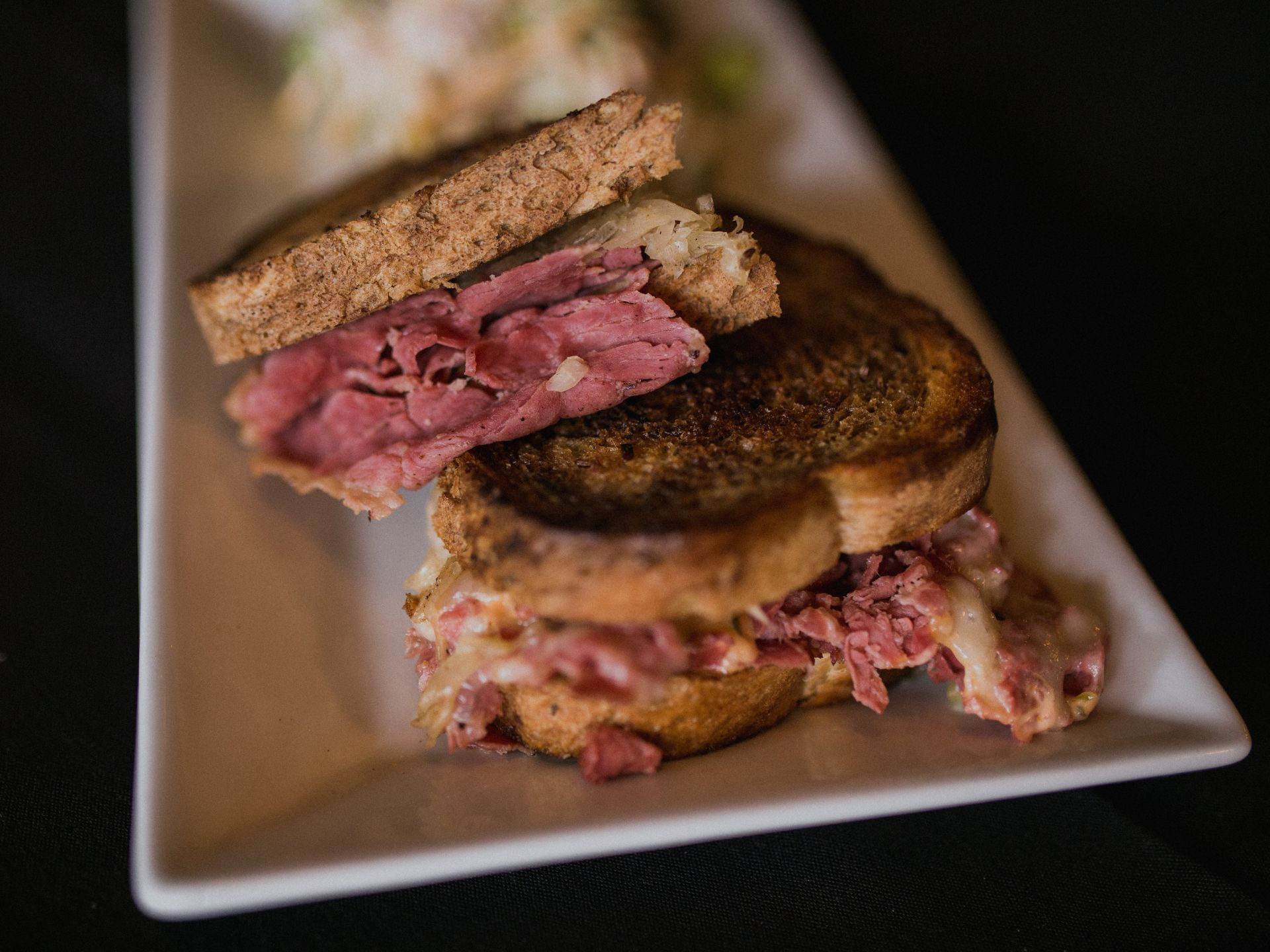 Reuben sandwich with sauerkraut on marble rye