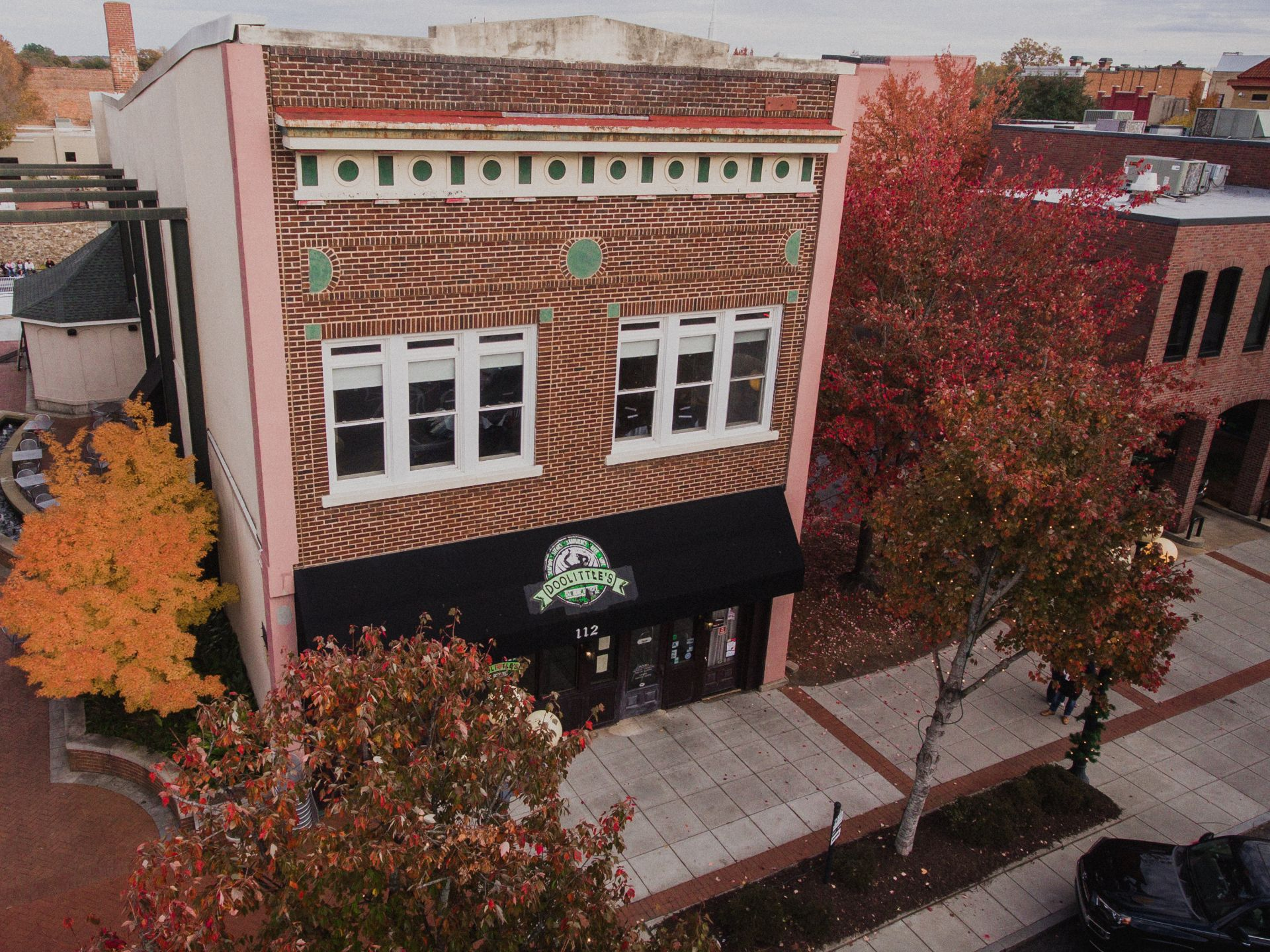 Aerial view of the exterior brick building of Doolittles