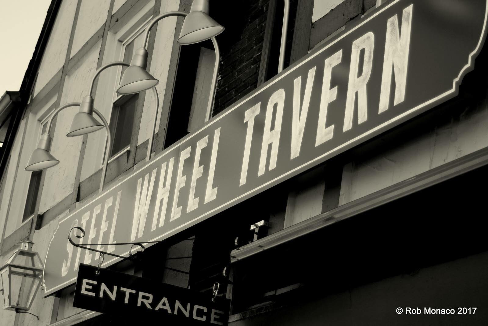 Steel Wheel Tavern sign black and white