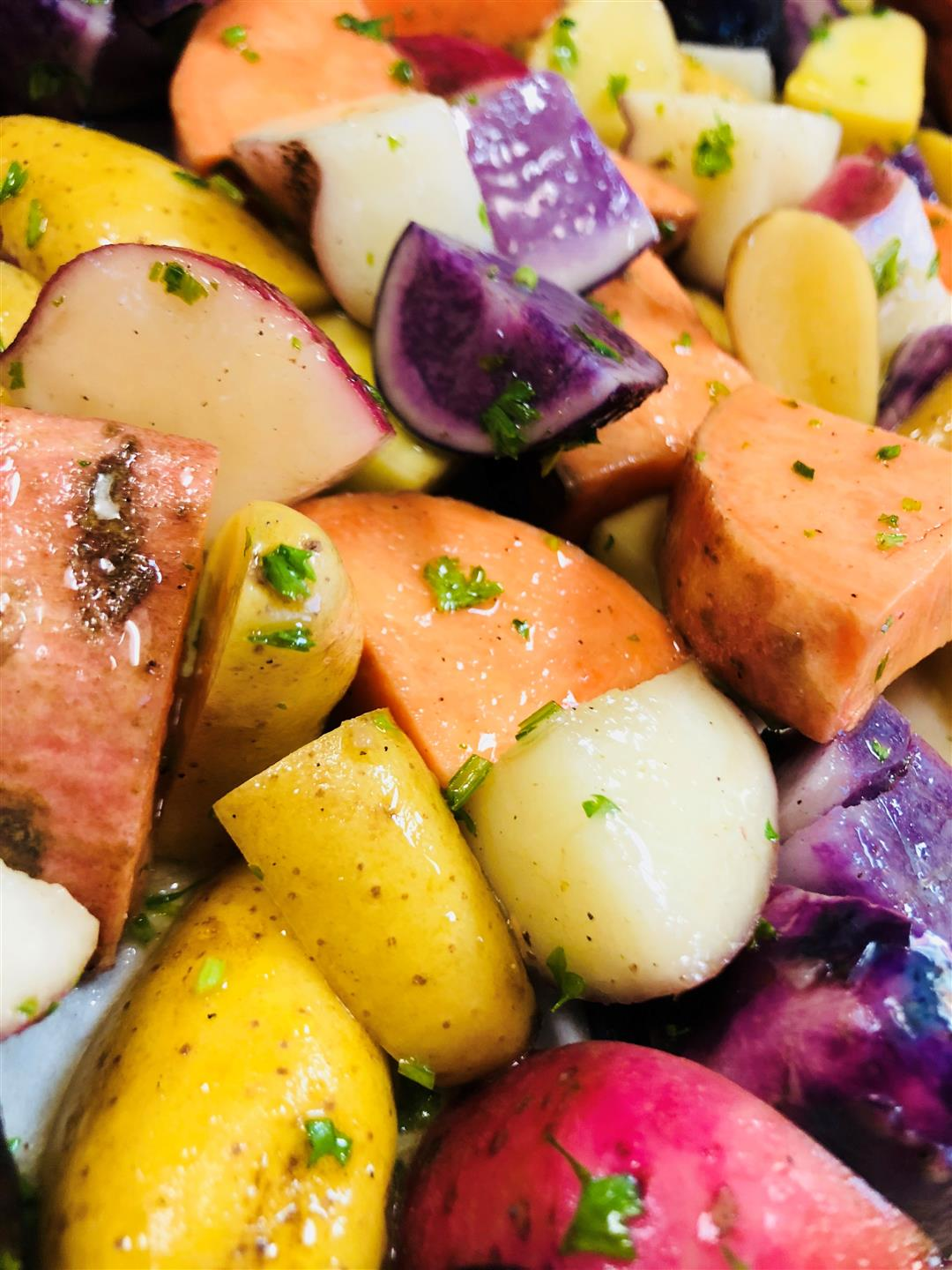 mixed colored potatoes: red, yellow, white, orange, and purple