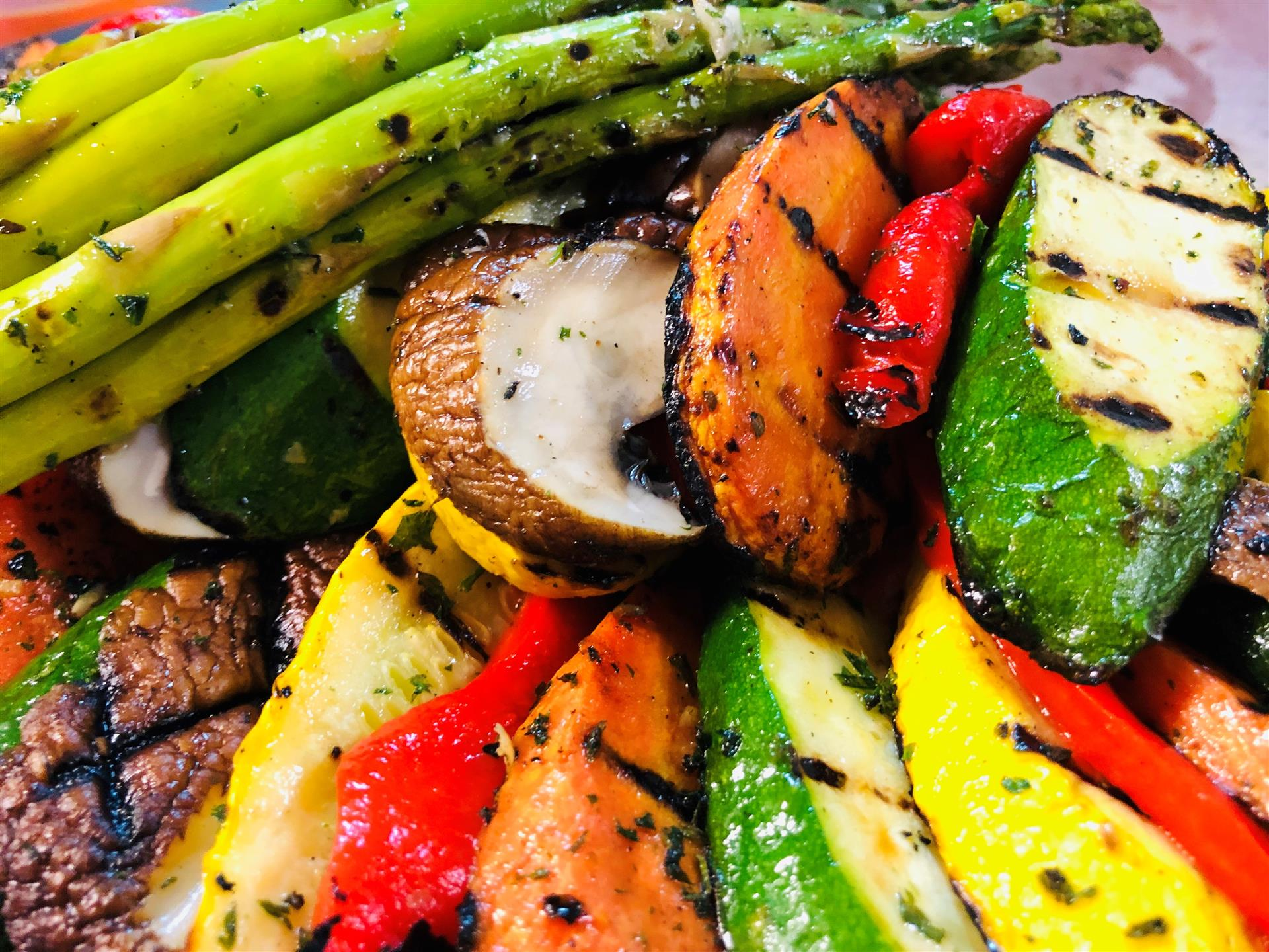 assorted grilled vegetables including asparagus, zucchini, carrot and potato