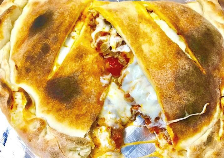 cheese calzone with tomato sauce, cheese and peppers
