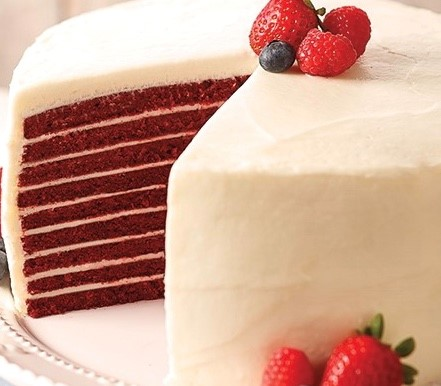 red velvet layered cake topped with fresh berries