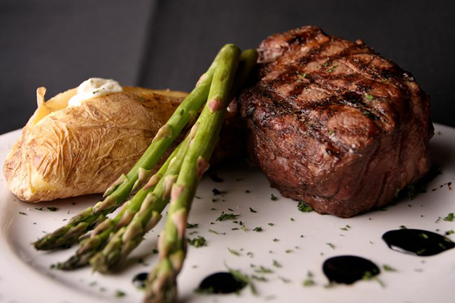 Grilled filet migon with asparagus and a baked potato