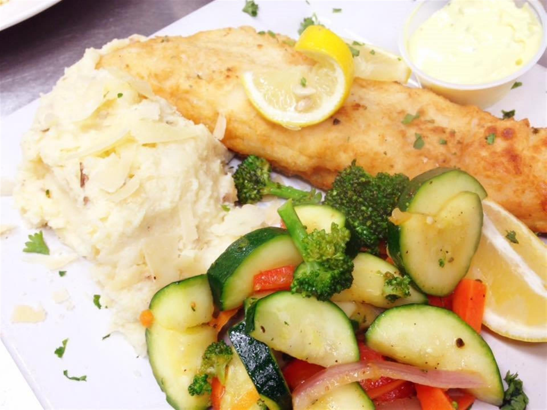 Mediterranean Walleye. Lake Erie Walleye filet dusted in Sicilian flour and pan fried in olive oil. Served with Asiago whipped potatoes and sautéed vegetables